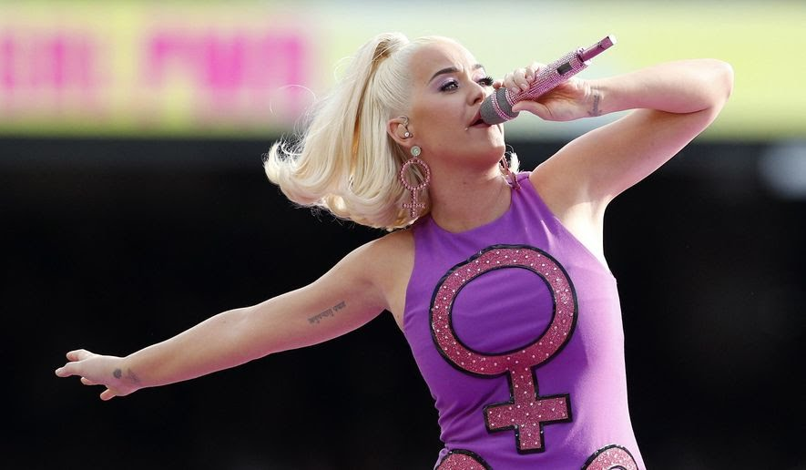 """Katy Perry performs prior to the Women's T20 World Cup cricket final match between Australia and India in Melbourne March 8, 2020. Perry's latest album """"Smile"""" will be released on Friday, Aug. 28.  (AP Photo/Asanka Ratnayake, File)"""